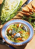 Carrot & cabbage stew with poppy seed dumplings