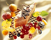 Tree cake on chocolate lattice, with fresh fruit