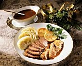 Roast goose with savoy and potato cakes