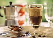 Espresso & cappuccino sundae, beside it cocoa powder & sieve