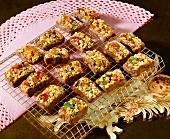 Praline squares on baking sheet