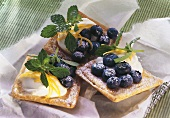 Tartlets with soft cheese and blueberries