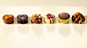 Assorted truffles in a row