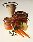 Apple & carrot jelly in jars, sugar behind