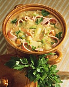 Potato stew with ham strips and parsley