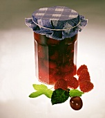 Raspberry and cherry jelly in preserving jar