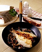 Finkenwerder plaice in the pan with bacon