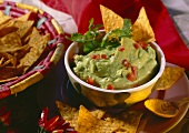 Bowl of guacamole, with tortilla chips