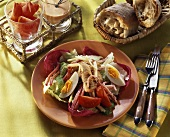 Mixed salad with strips of roast turkey fillet
