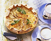 Apple tart with mint leaves, with cappuccino