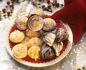 Christmas biscuits on plate, decoration: golden stars