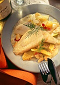 Plaice fillets on orange and leek sauce with almonds
