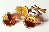 Grog, cloves, cinnamon sticks, star anise and orange slices