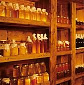 Various types of honey on wooden shelf