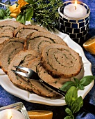 Roast pork roll with herb stuffing