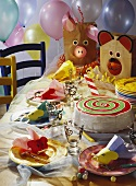 Brightly laid table for children's carnival with cake