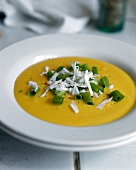 Cream of pumpkin soup with flaked coconut