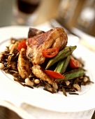 Roast chicken on wild rice, tomatoes and okra pods