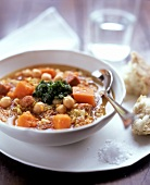 Stew with chick peas, pumpkin and paprika sausage