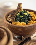 Chicken with spinach & sweet potato puree in wooden bowl