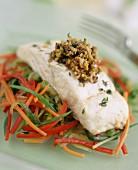 Turbot fillet with olive dressing on julienne vegetables