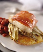 Cod wrapped in ham on potato rosti
