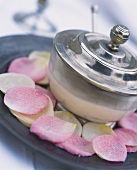 Cinnamon mousse with sugared rose petals in glass bowl