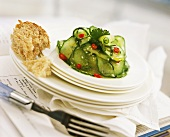 Cucumber salad with sesame and chili rings