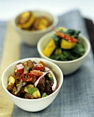 Various Indian vegetable accompaniments in bowls