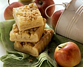 Several pieces of apple cake with crumble
