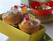 Marzipan muffins with icing and gummi bears