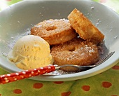 Cinnamon and apple fritters with vanilla ice cream