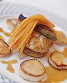 Monkfish medallions in artichoke bottoms with carrot strips