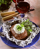 Frikadeller with coriander quark in aluminium foil