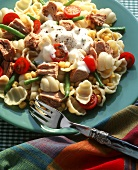 Pasta salad with tuna, cherry tomatoes and crème fraiche