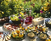 Buffet with various dishes on garden table