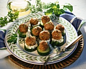 Pork balls with capers on cucumber slices