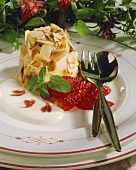 Timbale with flaked almonds, strawberry sauce & vanilla sauce