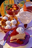 Strawberry cake, ice cream sundae, fruit salad & lemonade