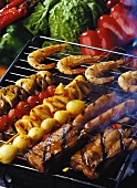 Vegetables, meat and shrimps on the grill