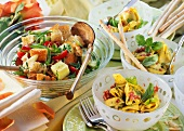 Bread & tortellini salads with salami, with grissini