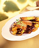 Roast goose breast on orange and red cabbage salad