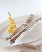 Spun sugar Christmas tree, with cutlery beside it
