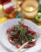 Goose breast carpaccio with watercress and beetroot