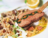 Shoulder of lamb stuffed with spinach, with raisin rice