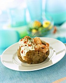 Baked potato with cream cheese and shrimps
