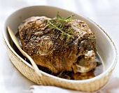 Braised leg of lamb with rosemary in a dish
