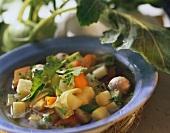 Kohlrabi stew with sausage dumplings on blue plate