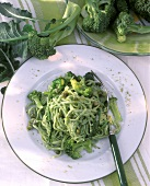 Spaghetti with broccoli & pistachio mousse on plate