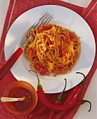 Spaghetti with spicy bean sauce on plate